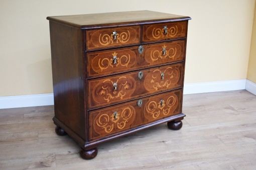 570 A George III Walnut and Marquetry Chest of Drawers CACN